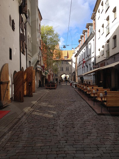 brown wooden bench beside street photo