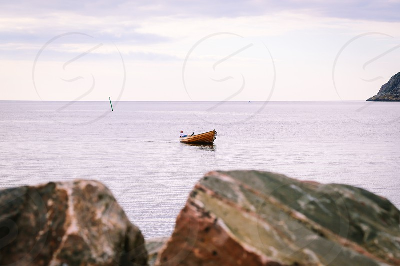 Transport transportation  boat wooden boat floating unrecognizable person open sea calmness calm sea tranquil  summer one boat photo
