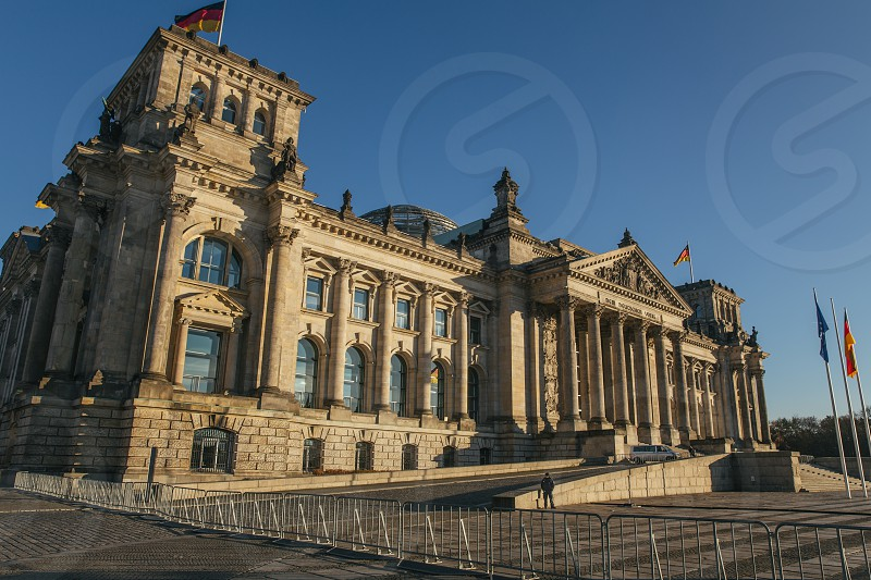Front view of the Reichstag building in Berlin in the sunny day photo