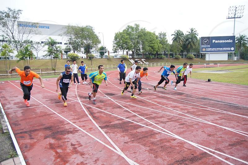 Runners starting on track from starting blocks photo
