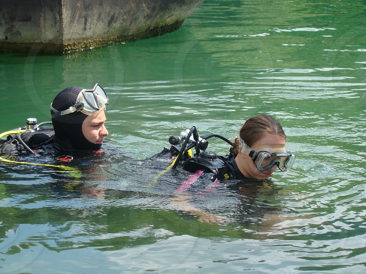 A pair of divers in the water.                    photo
