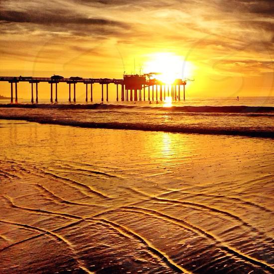 Sun setting over the pier in La Jolla CA photo