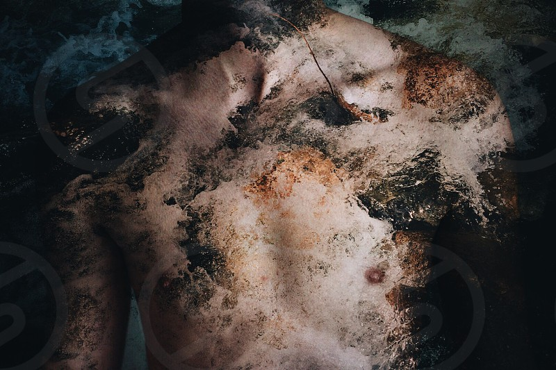 man's torso covered in dirt photo