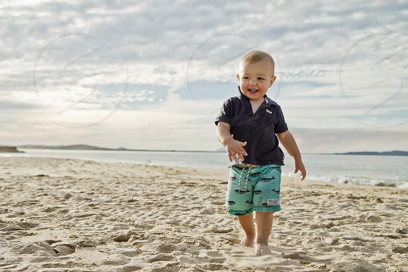 child beach happy summer sand noosa photo