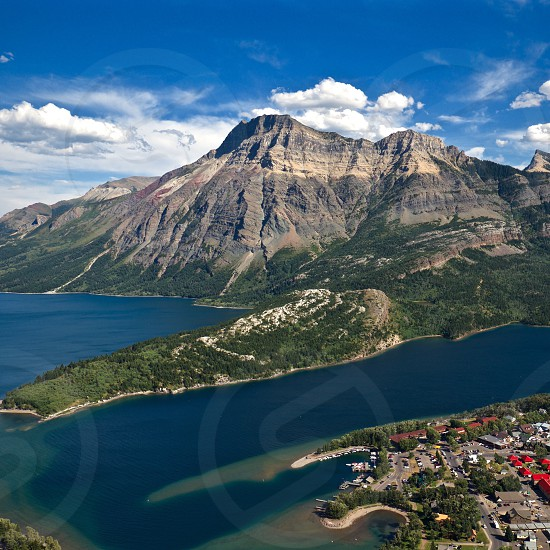 aerial shot of mountain and body of water photo