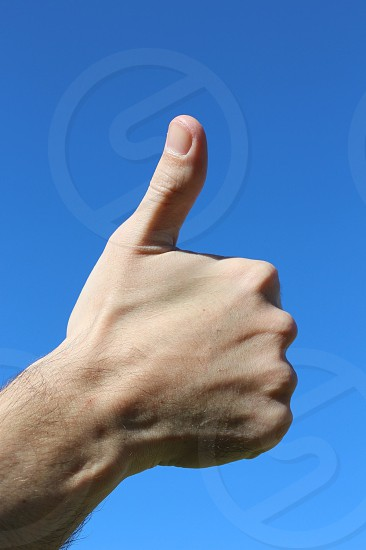 thumbs up hand gesture photo