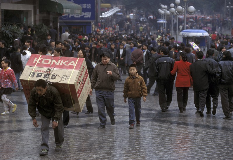 Transport people at the main square in the city of Chongqing in the province of Sichuan in china in east asia.  photo