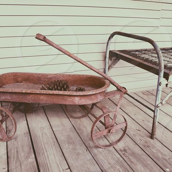 brown wheelbarrow photo