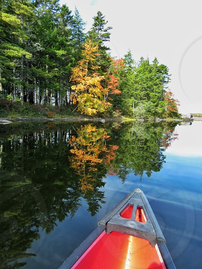 nature water canoe red paddling exercise landscape reflection colors relaxation photo
