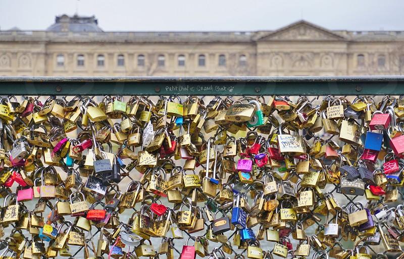 Locks of Love on a bridge in Paris France    photo