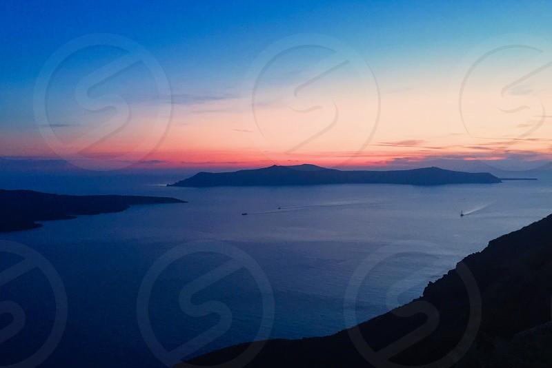 Santorini Greece sea water boat sunset island photo