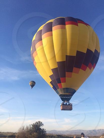 yellow and blue hot air balloon photo