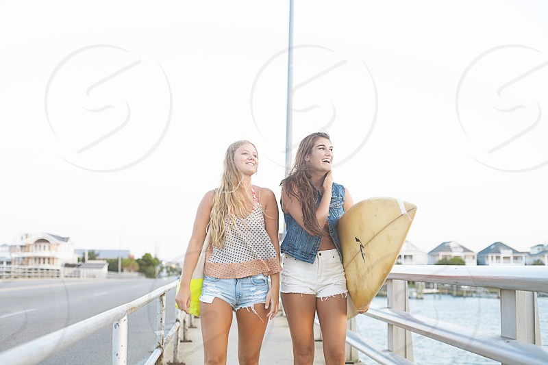 2 women standing at dock photo