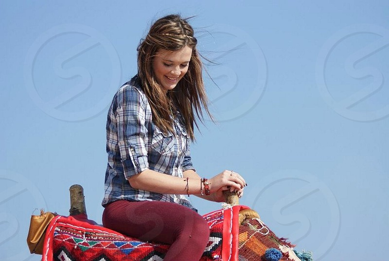 woman riding on saddl e photo