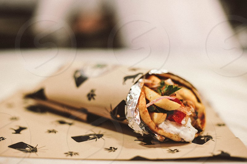 sandwich wrap on brown and black paper photo
