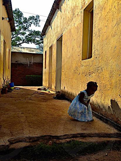 The child looking down child girl cute house  photo