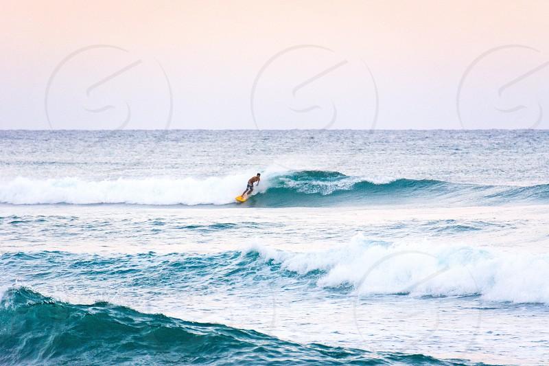 surfer surfing surf action sports orange surfboard waves blue water breaking photo