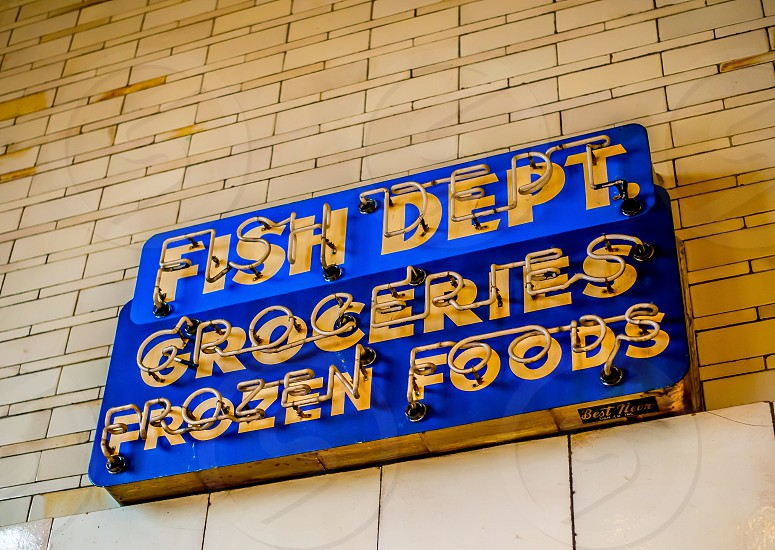 Neon sign outside the Fish Dept of the West Side Market in Cleveland Ohio photo