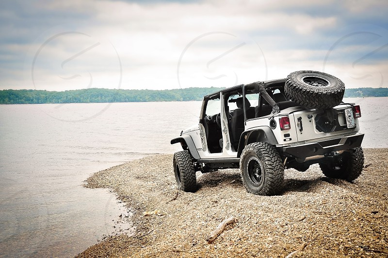 WEEKEND WARRIORS   Not much else describes warrior than conquering rocky hills & crazy trails without using a winch!  One of our favorite hobbies getting dirty on Jeep trails!  Taking a lunch break at Turkey Bay KY. photo