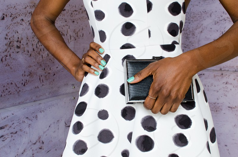 Woman purse polka dots clutch turquoise nails details  photo