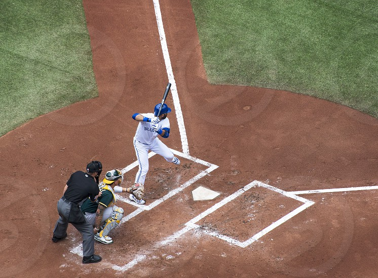 Jose Bautista batting for the Toronto Blue Jays versus the Oakland Athletics at the Rogers Centre in Toronto Canada.  photo