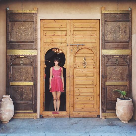 woman standing on door photo