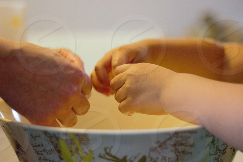 selective focus photo of child and person's hands photo