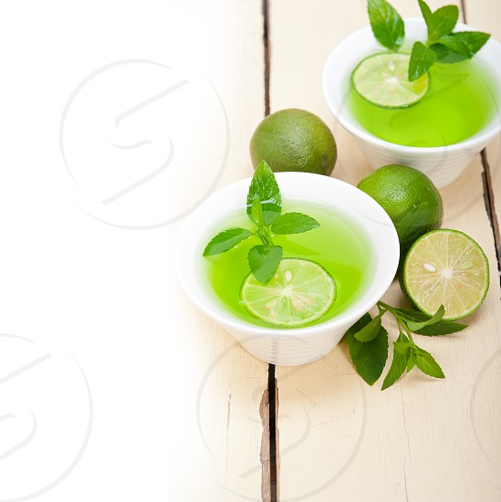 fresh and healthy mint infusion tea tisane with lime photo