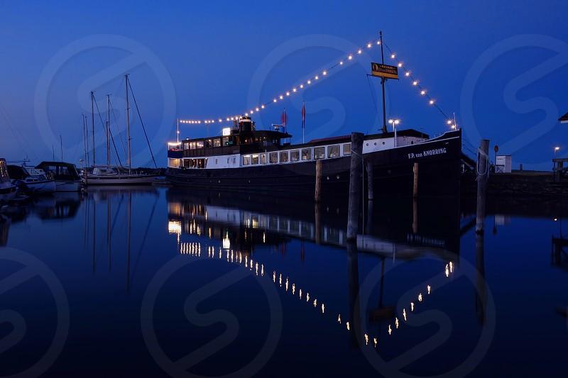 Mariehamn Finland - July 6 2013: Restaurant ship F.P. von Knorring in Mariehamn harbor on clear July night.  photo