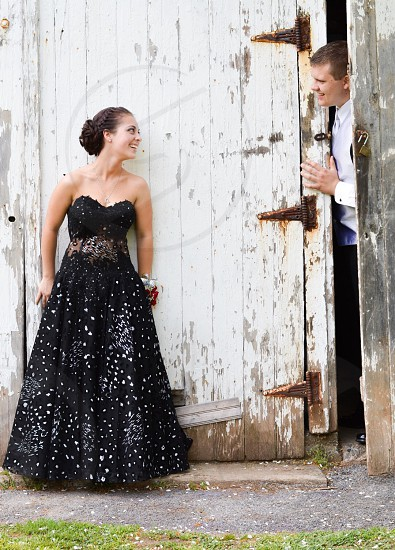 A loving couple dressed for prom photo