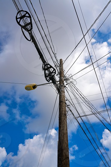 Messy electric aerial wires and pole in Mexico photo