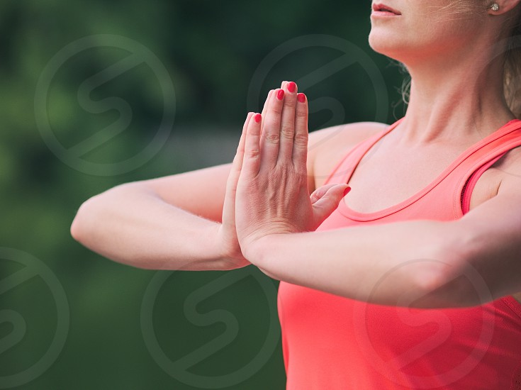 Woman in her Thirties Doing Yoga in the Park Closeup photo