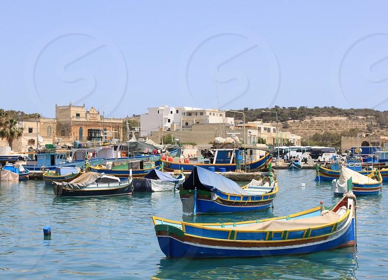 Malta Masrsaxlokk. Traditional fishing boats at a fishing village.  photo