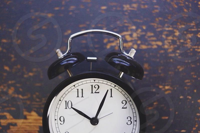black analog alarm clock  12:50 time photo