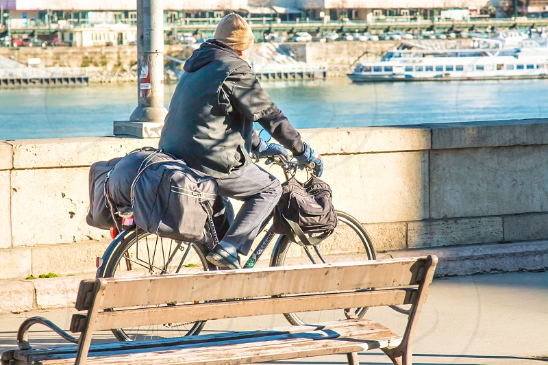 Senior Man With His Baggage Riding His Bicycle In The City photo