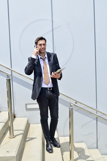 Businessman talking by mobile. photo