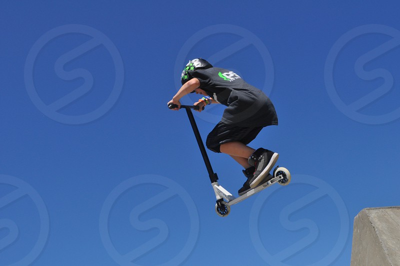 Scooter flying high photo