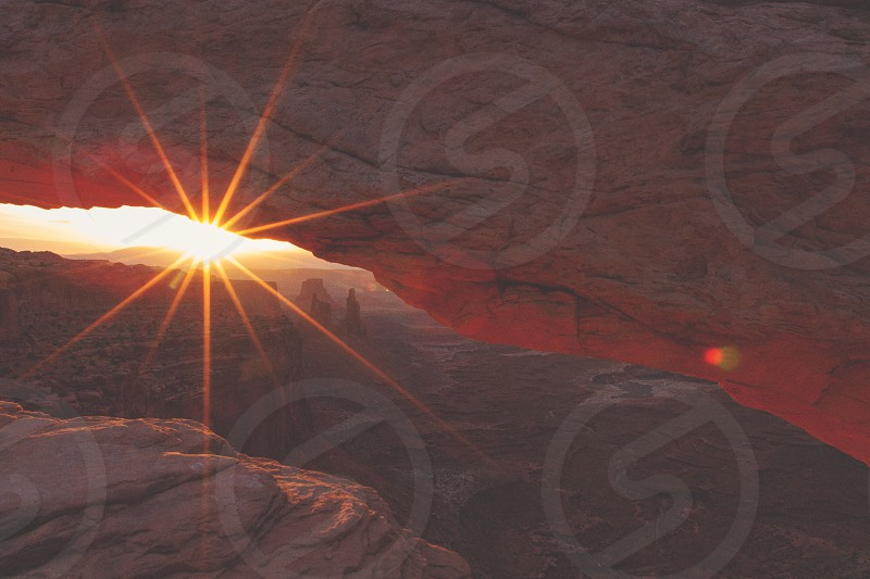 Sunburst on the Mesa Arch Canyonlands National Park.  Processed with Faded Ojai Fade Shadows and Grain. photo