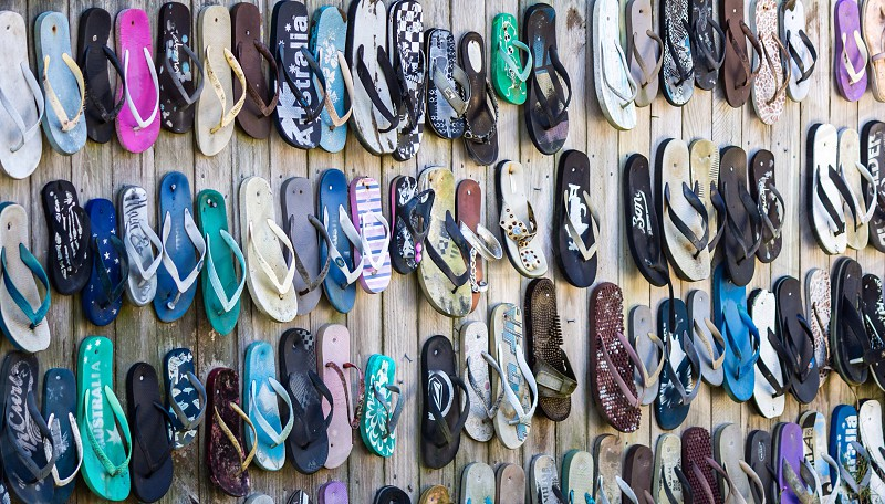 Wall thongs fence odd feet nailed flip flop wall photo