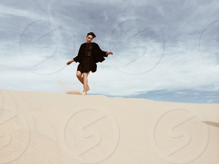 woman standing in the sand photo