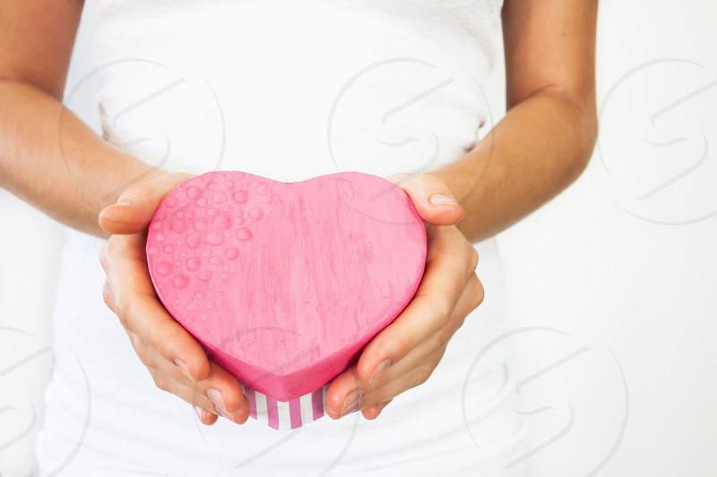 Gift heart in hands photo