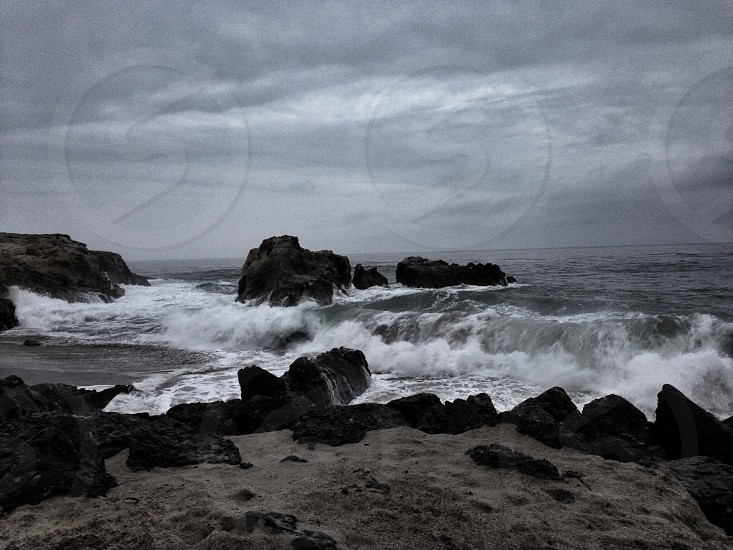 white waves on rock formation photo