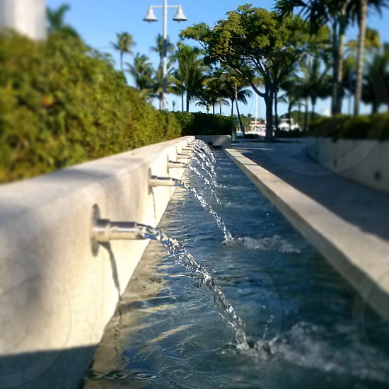 Water fountain in park at Waterfront West Palm Beach on Flagler and the Intracoastal Waterway photo