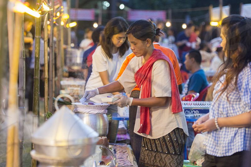 a traditional food market at the Phimai festival in the Town of Phimai in the Provinz Nakhon Ratchasima in Isan in Thailand.  Thailand Phimai November 2017 photo