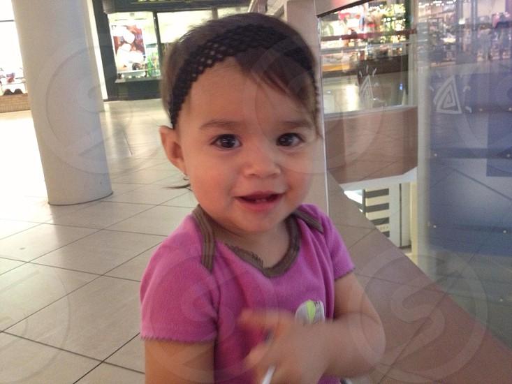 Little girl mall happy smile  photo