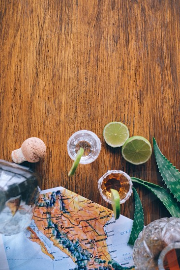 lime halves with salt and tequila photo