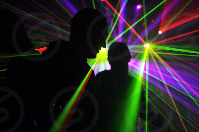 people standing in laser light show photo