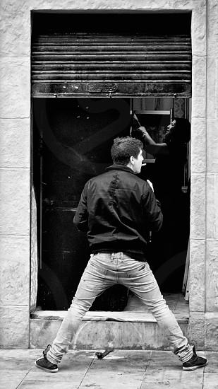 man wearing black leather jacket photo