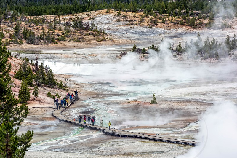 NORRIS GEYSER BASIN YELLOWSTONE/USA - SEPTEMBER 26 : People walking around the Norris Geyser Basin in Yellowstone on September 26 2013. Unidentified people. photo