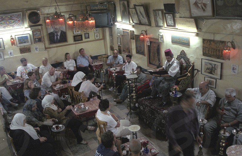 the storyteller Abu Shady ii Cafe An Nafura  in the market or souq in the old town in the city of Damaskus in Syria in the middle east photo